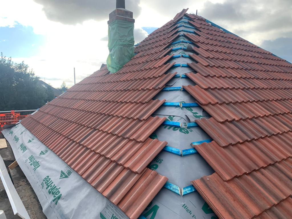 tiles being added to roof